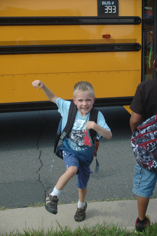 Now six-year-old Nathan returning from his first day of Kindergarten in September, 2013.  I hope his enthusiasm endures for all things academic.